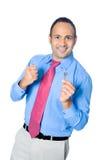 Uomo d'affari che mostra fuori un tasto immagini stock libere da diritti