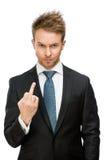 Uomo d'affari che mostra gesto osceno fotografia stock