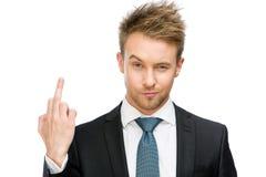 Uomo d'affari che mostra gesto volgare immagine stock libera da diritti