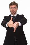Uomo d'affari che mostra i pollici su e giù Fotografie Stock Libere da Diritti