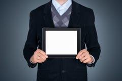 Uomo d'affari che mostra il ipad in bianco della mela Fotografie Stock