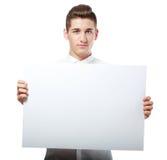 Uomo d'affari che mostra insegna in bianco Fotografia Stock