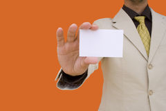 Uomo d'affari che mostra la sua scheda Immagine Stock Libera da Diritti