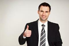 Uomo d'affari che mostra pollice su Fotografia Stock