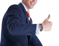 Uomo d'affari che mostra pollice in su e sorridere Fotografie Stock