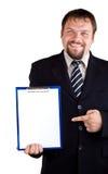 Uomo d'affari che mostra sui appunti Immagine Stock