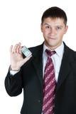 Uomo d'affari che mostra un batuffolo di soldi Immagini Stock