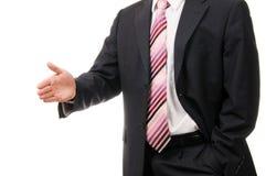 Uomo d'affari che offre agitare la vostra mano. immagini stock