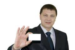 Uomo d'affari che osserva da dietro uno spazio in bianco bianco Immagini Stock Libere da Diritti