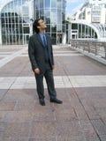 Uomo d'affari che osserva fuori Fotografia Stock Libera da Diritti
