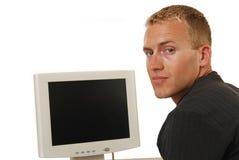 Uomo d'affari che osserva sopra la sua spalla Fotografia Stock