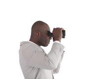Uomo d'affari che osserva tramite il binocolo Immagine Stock Libera da Diritti