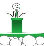 Uomo d'affari che parla al pubblico in una conferenza Fotografia Stock