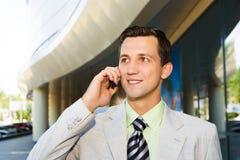 Uomo d'affari che parla sul telefono Immagine Stock Libera da Diritti