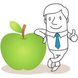 Uomo d'affari che pende contro la mela Fotografia Stock