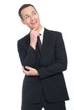 Uomo d'affari che pensa e che sorride Fotografie Stock Libere da Diritti