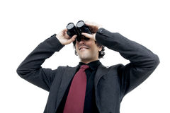 Uomo d'affari che per mezzo del binocolo Fotografia Stock Libera da Diritti