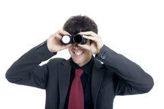 Uomo d'affari che per mezzo del binocolo Immagini Stock Libere da Diritti
