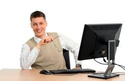 Uomo d'affari che per mezzo del calcolatore Fotografia Stock Libera da Diritti