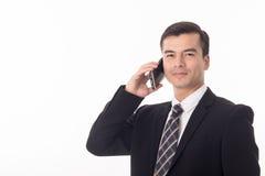 Uomo d'affari che per mezzo del telefono astuto fotografia stock libera da diritti