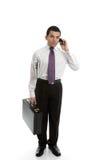 Uomo d'affari che per mezzo del telefono delle cellule Fotografia Stock Libera da Diritti