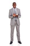 Uomo d'affari che per mezzo del telefono delle cellule Fotografia Stock