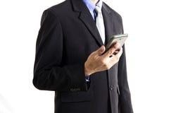 Uomo d'affari che per mezzo del telefono mobile Fotografia Stock