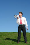 Uomo d'affari che per mezzo di un megafono Immagine Stock