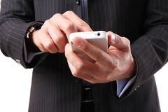 Uomo d'affari che per mezzo di un telefono mobile Fotografie Stock