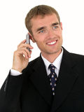Uomo d'affari che per mezzo di un telefono mobile fotografia stock