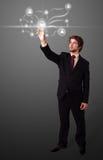Uomo d'affari che preme tipo sociale moderno di icone Immagine Stock