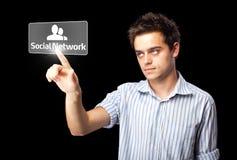 Uomo d'affari che preme tipo sociale moderno di icone Fotografia Stock Libera da Diritti