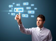 Uomo d'affari che preme tipo sociale moderno di icone Immagine Stock Libera da Diritti