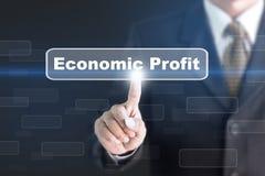 Uomo d'affari che preme un bottone di concetto di profitto economico Immagini Stock Libere da Diritti