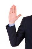 Uomo d'affari che prende giuramento. Immagine Stock