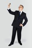 Uomo d'affari che prende un selfie Immagini Stock Libere da Diritti