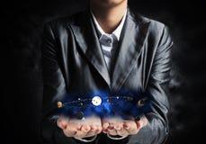 Uomo d'affari che presenta sistema solare Immagini Stock Libere da Diritti
