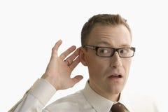 Uomo d'affari che prova a sentire - isolato Fotografia Stock