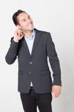 Uomo d'affari che pulisce il suo orecchio Fotografia Stock
