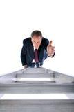 Uomo d'affari che raggiunge per la guida Fotografia Stock
