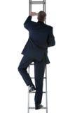 Uomo d'affari che sale una scala Fotografie Stock Libere da Diritti