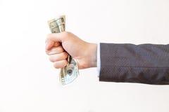 Uomo d'affari che schiaccia le banconote nel bianco isolate fotografia stock