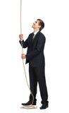 Uomo d'affari che sciama sul cavo Immagini Stock Libere da Diritti