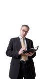 Uomo d'affari che scrive al taccuino Immagini Stock