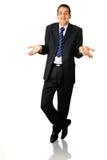 Uomo d'affari che scrolla le spalle entrambe le spalle fotografia stock