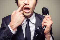 Uomo d'affari che seleziona il suo naso Immagine Stock Libera da Diritti