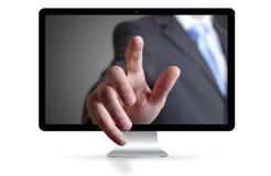 Uomo d'affari che sfugge dal computer Fotografia Stock Libera da Diritti