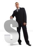 Uomo d'affari che si appoggia sul segno del dollaro Fotografie Stock