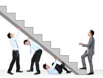 Uomo d'affari che si arrampica in su Fotografie Stock