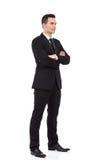 Uomo d'affari che si leva in piedi con le braccia attraversate Fotografia Stock